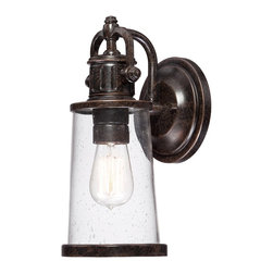 Quoizel - Quoizel SDN8405IB Steadman Outdoor Wall Lantern - This fixture gives the exterior of your home both beauty and an industrial sense of design.  It features a vintage bulb for a historic look and is enhanced by the clear seedy glass.  The Imperial Bronze finish completes the look.