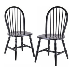 Winsome Windsor Black Chairs with Carved Leg - 2 Chair Set - Add drama and beauty to your dining area with this set of two Windsor Chairs With Carved Legs. These chairs are a lovely addition to any dining set and they feature round backs and beautifully carved turned legs. They are made from solid beech wood in a rich black finish perfect for any decor. Ships fully assembled. Dimensions: 17.25W x 18D x 36.1H inches. About Winsome TradingWinsome Trading has been a manufacturer and distributor of quality products for the home for more than 30 years. Specializing in furniture crafted of solid wood Winsome also crafts unique furniture using wrought iron aluminum steel marble and glass. Winsome's home office is located in Woodinville Wash. The company has its own product design and development team offering continuous innovation.