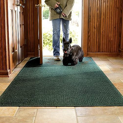"""Frontgate - WATER & DIRT SHIELD ™ 1'6"""" x 2'3"""" Entry Mat - Designed to capture the dampest, dirtiest tracks. 100% polypropylene (20% recycled content) fibers can absorb an entire gallon of water per square yard. Crush-resistant nubs remove and trap mud from feet. Raised rubber border ensnares every drop of water in each mat. Slip-resistant backing holds mat firmly in place. This WATER & DIRT SHIELD ™ Entry Mat absorbs water and scrapes mud from shoes and paws to keep your entryway clean and dry. Take your dog out in a downpour and walk back through the door without a worry. . . . . . Suitable for all floor types. Absorbs 1 gallon of water per square yard. Surface wash with mild detergent or rinse with a hose. Note: Do not place on wet floors. Made in USA."""