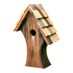 Heartwood - Nottingham Bird House - Welcome  to  Nottingham,  where  thrilling  adventures  await  you  and  your  merry  band  of  birds,  with  a  home  that's  sure  to  steal  hearts  and  give  years  of  blissful  birding.  Curving  asymmetrical  design  and  bark-like  rustic  scored  exterior  evoke  Old  English  forests  and  ageless  natural  splendor,  while  happily  ever  after  is  assured  thanks  to  superb  solid  cypress  construction.  Isn't  time  you  added  this  bit  of  timeless  beauty  to  your  yard  or  garden?                   6x10x15              1-1/2  hole              Handcrafted  in  USA  from  renewable,  FSC  certified  wood