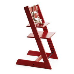 Stokke Classic Tripp Trapp High Chair in Red - Gone are the days of filling the dining room with an obstructing enormous high chair. This modern take comes with all of the classic safety and convenience features, such as the 5-point harness and adjustable seat depth. The optional cushion is machine washable, and the wood finish also comes in different colors (though this red is just plain fun).