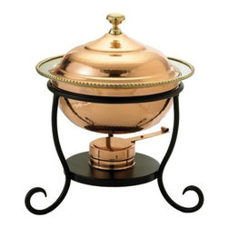 Old Dutch Round Decor Copper Chafing Dish - From soups to side dishes your favorite dishes will dazzle in the Old Dutch Round Decor Copper Chafing Dish. Beautifully crafted from strong durable copper with a brilliant gleam this elegant oven-safe chafing dish boasts a deep round shape and matching domed cover accented with a round knob. Lacquered to resist tarnishing it features a black metal frame with scrolled legs for a lovely classic flair. Adjustable gel-fuel holders keep your food at just the right serving temperature and it comes in your choice of size. About Old Dutch InternationalFamous for their copperware Old Dutch International Ltd. has been supplying the best in imported housewares and giftware to fine retailers throughout America since 1950. They offer a large assortment of housewares including bakers racks trivets and pot racks in materials like chrome colorful enamel and stainless steel. Other product lines include wine racks serving trays specialty cookware clocks and other home accessories. Old Dutch warehouses and distributes their products from a 30 000 square foot facility in Saddle Brook N.J.