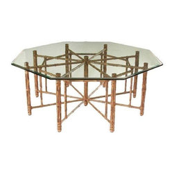 McGuire Reeded Bamboo Octagonal Dining Table - We're totally caught up in the web-like design of this grand dining table, designed by John McGuire. It features bamboo poles lashed in place with McGuire's signature rawhide laces. The design has a center support of bundled bamboo. Horizontal bamboo members radiate from this center support and join eight inner supports and outer bamboo legs to create its beautiful, geometric form. A timeless piece and about the best you can get from the top design manufacturer, McGuire. This table graces the cover of an older issue of Architectural Digest from a Manhattan penthouse designed by the renowned late furniture designer, Jay Spectre. Table has minor flaws include hairline scratch on the bottom third of one of the angles that runs about six inches.  It comfortably seats eight.