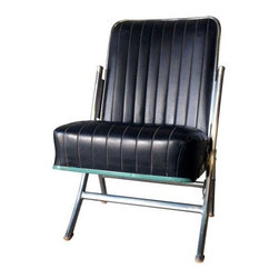 """Used Mid-Century  Theatre Style Folding Chair - Mid-Century theatre style folding chair. Black vinyl channel upholstery is in great condition. Folds and unfolds easily. Perfect as an occasional chair in a living room or would be fun in a media/game room.     Folded dimensions are 35""""H x 7.5""""D x 20""""W. Seat Height measures 17""""."""