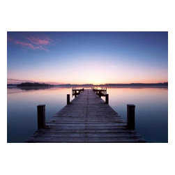 Pier At Sunrise Wall Mural - This picturesque mural of a wooded pier at sunrise envelops the serene beauty of the first light of dawn. A peaceful seascape has yet to be awakened against a warm orange sky brilliant and gorgeous.