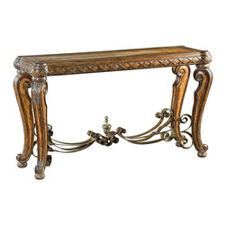 """Ambella Home - Morales Console Table - If the look of Spanish interiors speaks to you, this hardwood console table is certain to make you say, """"Ole!"""" Carved legs and intricate details create a stunning showpiece, while the forged iron stretcher between the legs adds dramatic impact. Completing the picture is a eucalyptus and koto veneer."""