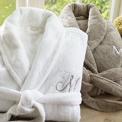 Cozy Robe, Medium, White - Made from soft, thick poly microfiber, our deeply plush robe warms and relaxes with true spa style. 100% brushed microfiber polyester in a knitted weave. 300-gram weight. Cut with a full shawl collar, roll-up long sleeves, two patch pockets and a self belt. Hangs from a loop at the collar. Monogramming is available at an additional charge. Monogram will be placed on the upper left-side of the robe. Made in Turkey.