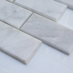 "Sample Asian Statuary Beveled 2x4 Marble Tile1/4 Sheet - sample ASIAN STATUARY BEVELED 2X4 1/4 SHEET SAMPLE You are purchasing a 1/4 sheet sample measuring approximately2 "" x 4"". Samples are intended for color comparison purposes, not installation purposes. -Glass Tiles -"