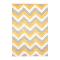 Safavieh - York Hand Tufted Rug, Grey / Gold 9' X 12' - Construction Method: Hand Tufted. Country of Origin: India. Care Instructions: Vacuum Regularly To Prevent Dust And Crumbs From Settling Into The Roots Of The Fibers. Avoid Direct And Continuous Exposure To Sunlight. Use Rug Protectors Under The Legs Of Heavy Furniture To Avoid Flattening Piles. Do Not Pull Loose Ends; Clip Them With Scissors To Remove. Turn Carpet Occasionally To Equalize Wear. Remove Spills Immediately. Update your living room, bedroom or entry hall with a beautifully textured Askot area rug featuring an over-scaled Moroccan motif that has graced beautified artisan tile floors for centuries. Hand-tufted of superior wool pile and crafted to endure, this s
