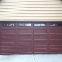 Traditional Raised Panel Garage Doors - Here is another great example of a garage door with a Classic Cherry Wood Grain and how it can make the garage door pop!