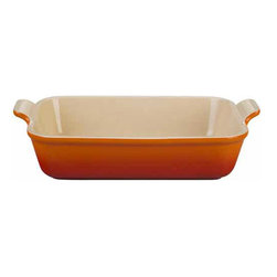 Le Creuset - Le Creuset Heritage Stoneware 12-by-9-inch Rectangular Baking Dish - Le Creuset stoneware dishes are versatile, multipurpose designs that offer all the even-heating benefits of stoneware in a variety of shapes and capacities to fit nearly any baking, roasting or broiling recipe. Each dish features grooved handles for a sure grip, plus Le Creusets glazed interior that protects against utensil damage, staining and odor absorption  making each dependable piece of stoneware easy to use and easy to count on.