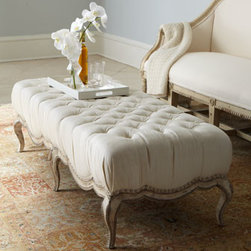 "Horchow - Milania Tufted Ottoman - Unique ottoman blends casual elegance with feminine flair. It works well both as additional seating and as a coffee table alternative. Imported. Solid hardwood frame with intricate carving on legs. Button-tufted linen top. Nickel nailhead trim. 60""W..."