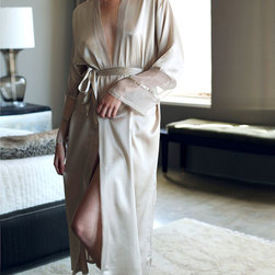 Paris Long Robe - A soft and entrancing lustre born of sophistication and elegance befits a robe inspired by the City of Light. The Paris Long Robe is composed of fine silk charmeuse that creates a gently flowing silhouette. The organza trim on the cuffs and center front add an unexpected detail that is at once fashionable yet refined.