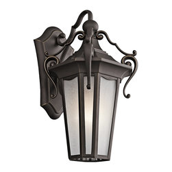 Kichler Lighting - Kichler Lighting Nob Hill Traditional Outdoor Wall Sconce X-ZR61494 - This Kichler Lighting Nob Hill Traditional Outdoor Wall Sconce is definitely an eye-catching piece. Notice the prominent scroll work of the cast aluminum frame in a rich and warm rubbed bronze finish and the panels of etched seedy glass. It's an elegant piece with a timeless appeal, and one that's sure to gain praise and admiration from anyone who sees it hanging in your home.
