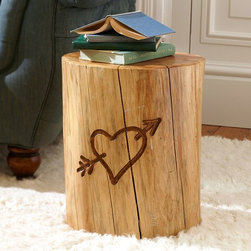 The Emily + Meritt Tree Trunk Side Table - Add some decorative touches like a stack of books or a patterned tray on this fun tree trunk side table.