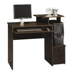 Sauder Beginnings Student Desk, Cinnamon Cherry - This computer desk features an elevated monitor/printer shelf and a slide-out keyboard shelf to save space. It also has space for the main computer unit and storage in the cabinet underneath. As a bonus, it's very affordable too!