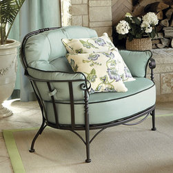Ballard Designs - Corsica Lounge Chair - Powder coated to resist rust, peeling & chipping. Fully welded wrought iron frame. Non-mar footpads. Deep Chocolate finish. Made in USA. Our Lounge Chair with curving, scrolled arms with bolster pillows and extra thick cushions embrace you in curl-up comfort. Cushions come in your choice of Sunbrella fabrics with rope twist cording.Lounge Chair features: . . . .  . Replacement cushions available.