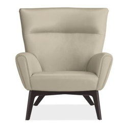 Boden Chair - A Room & Board favorite, Boden's dramatic angles, high back and sculptural wood base make it a bold accent chair. The distinctive design features a roomy, comfortable seat that offers a perfect place to stretch out and lounge, especially when paired with an ottoman.