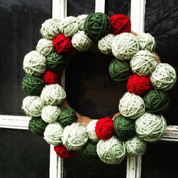 Primitive Christmas Wreath by Down in the Boondocks - Clusters of yarn create a cute wreath with a primitive feel. This is a fun, whimsical and long-lasting alternative to greenery.