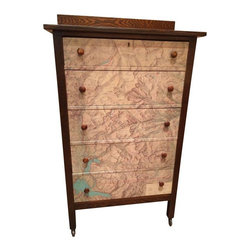 """Pre-owned Antique Mission Oak Chest - """"Ruggedly handsome"""" is the only way to describe this antique mission-style solid oak five drawer chest. Featuring a vintage 1961 map of Rocky Mountain National Park (CO) on the drawer fronts. Working casters on the legs facilitate easy rolling. The top drawer has working lock with key for stashing all your secrets. Despite its age, all drawers glide smoothly, and have been lined with hounds-tooth paper that coordinates perfectly. Original oak knobs. Comfortably at home in the lodge, cabin or anywhere you need a strong masculine presence. You can climb all through those mountains, but you won't find another one like this."""