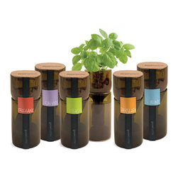 GrowBottle Upcycled Hydrogardens - Repurposed from old wine bottles, these individual herb pots are the perfect addition to any sunny and neglected window sill. Unlike the potted herbs that you can buy at the grocery store, these planters are actually decorative objects that will add interest (in a positive way) to your kitchen.