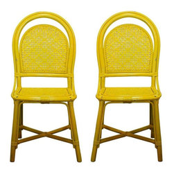 Pre-owned Vintage Yellow Rattan Cafe Chairs - A Pair - These beauties were found while scouring east coast vintage markets.  This pair of vintage yellow rattan side chairs are quaint and stylish. Try them out for pops of color in your kitchen or set up the perfect indoor/outdoor seating area.