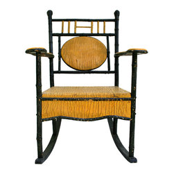 Adirondack Rocker - A wonderful piece of Americana. Antique porch rocker in bright yellow and black paint. Layers of old original crackled paint over wood. Incredible folk art detailing.