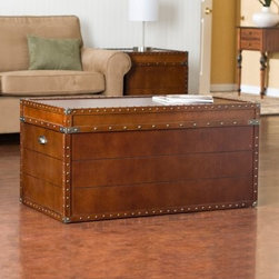 Southern Enterprises Streamer Trunk Coffee Table - We're not sure what a steamer is but we are sure this Southern Enterprises Steamer Trunk Coffee Table is a fine fine table. Not only is it a superb coffee table it also functions as an ideal storage unit for all your clutter-clearing needs. And don't worry about that easy-open lid slamming on your fingers it's equipped with progressive hinges to prevent such a catastrophe—don't you feel safer already? The luscious walnut finish is accented by replicated antique brass hardware that begs to be labeled authentic. Placed either in your bedroom or living room this table is sure to suit your decorative and functional needs. Table measures 39W x 20.5D x 19H inches and requires some assembly.About SEI (Southern Enterprises Inc.)This item is manufactured by Southern Enterprises or SEI. Southern Enterprises is a wholesale furniture accessory import company based in Dallas Texas. Founded in 1976 SEI offers innovative designs exceptional customer service and fast shipping from its main Dallas location. It provides quality products ranging from dinettes to home office and more. SEI is constantly evolving processes to ensure that you receive top-quality furniture with easy-to-follow instruction sheets. SEI stands behind its products and service with utmost confidence.