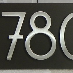 Personalized Modern Address Plaque - A 4-digit plaque. Stainless steel bungalow style house numbers on a dark bronze plaque. These numbers are offset to the right for a more modern visual. The numbers have a brushed finish.