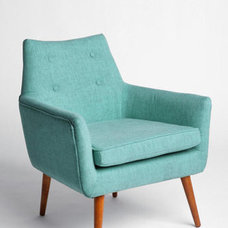 modern chairs by DE LA ROQUE PARIS Inc.