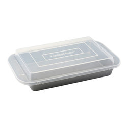 Farberware - Farberware Bakeware 9-inch x 13-inch Covered Cake Pan - This handy covered cake pan eliminates the need for a separate storage container. Bake your cake in the tough carbon-steel non-stick pan,and snap on the elevated plastic lid to keep the cake fresh and protected at home or in transit.
