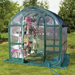 Flowerhouse - Flowerhouse Springhouse Greenhouse - 8110637 - Shop for Greenhouses from Hayneedle.com! Create the perfect place for your plants and flowers to thrive with the Flowerhouse Springhouse Greenhouse. This greenhouse is made with clear poly panels and supported by a durable fiberglass frame. It features zipper closure doors 4 ports for hoses or power cords and ground stakes to keep it stable during high wind. It also comes complete with a handy shade cover as well as an included carry pack. Simply add your own shelves and get to growing!