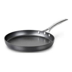 """Calphalon - Calphalon Unison Slide Non Stick Round Griddle Pan 12"""" - The specially textured Calphalon Unison SEAR Non Stick surface seals in flavor and is ideal for sauteed vegetables, braised beef, chops and cutlets and pan sauces. The wide flat-bottom surface is ideal for searing and low sides allow air to circulate so that foods remain crisp, yet high enough to contain juices and prevent splattering. Low sides allow air to circulate so that foods remain crisp, yet high enough to contain juices and prevent splattering. Heavy-gauge hard anodized aluminum. Spun or drawn construction provides superior conductivity and even, consistent heat. Will not chip, crack and warp. At last, Non Stick cookware that lets you cook like a professional. Free your culinary spirit, try a new recipe or improvise your own creation - Sear Non Stick makes it easy to express your culinary creativity. The specially textured Sear Non Stick surface has the searing capability that true chefs demand from professional-grade cookware, yet all the convenience of Non Stick. Cast, brushed stainless steel. Ergonomic, stay-cool handles. Triple-riveted for durable performance. Domed, tempered glass with stainless steel rim Oven safe up to 500 F degrees / 260 C degrees Cleaning. Before using for the first time, wash in warm, sudsy water. For hand washing, use a liquid dishwashing detergent such as Dawn and a sponge or soft bristle brush. For automatic dishwashing detergent, we recommended Cascade. To remove spots or stains from the hand anodized exterior use the recommended liquid dishwashing detergent and a non-abrasive pad or sponge. Allow to cool before cleaning. Never immerse a hot pan in cold water; doing so can cause irreparable warping. Dishwasher For the perfect pair, look for Calphalon Unison cookware with Slide Non Stick. Its revolutionary, ultra-smooth Slide Non Stick surface releases foods effortlessly, essential for creating tender omelettes and delicate sauces. Lifetime warranty.."""
