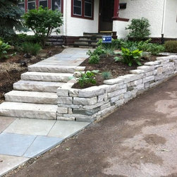 Stone Retaining Walls and Sitting Walls - Craftsman wall with stone steps.