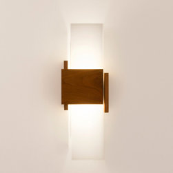 "Cerno - Acuo Sconce - Acuo Sconce Light  by Cerno  At A Glance:       Abstract but traditional, the Acuo wall sconce features the classic grain of Walnut while assuming a modern form that makes linear shapes into a cohesive whole. This sconce light uses energy-saving LED technology with a warm glow.  What's To Like:   The Acuo Wall Sconce has a warm look both when it's turned on and off. Walnut is one of the warmest wood tones, and the warm light of the LEDs used in this sconce is a far cry from the cold light that early LEDs put off.  Features: Overall dimensions: 16.5"" h x 4"" d x 6"" wPolymer shadeWalnut wood bodyDimmable (use ELV or TRIAC dimmer)Light output: 430 lumensLight color: 2700 degrees K (warm)LED power consumption: 6.5 wattsHandmade in California, USA"