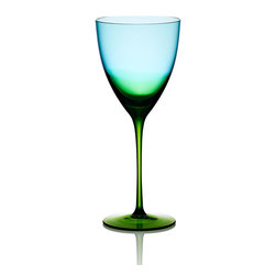 Vague Glass White Wine Glass - An enchanting blend of blue and green glass, the Vague Glass White Wine Glass inspires daydreams of cool summer evenings when daylight and twilight mingle on the horizon in a captivating wash of color. A perfect vessel for enjoying a chilled wine as you relax at end of day or for serving guests a superb vintage.