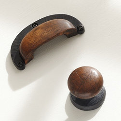 "Equestrian Hardware - This cabinet hardware looks as though it could have been salvaged from a barn.  The mixture of wood and metal gives these knobs a warmth that most hardware doesn't have. Dimensions: Knob: 1.5"" diam. x 1.5""H. Horseshoe pull: 3.5""W x 0.75""D X 1.75""H. Set of 4."