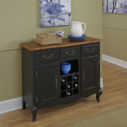 HomeStyles - Oak and Rubbed Black Buffet - The buffet is constructed of hardwood solids and engineered wood in a distressed oak and heavily rubbed black finish showcasing a bit of base coat providing a weathered look. The oak top features several distressing techniques such as worm holes, fly specking, and small indentations. Additional features include three storage drawers, two storage doors with adjustable shelves, removable wine rack, and one center fixed shelf. Beautifully accented with shaped, carved proud legs, corner peg accents, and detailed brass hardware. Assembly required. 44.25 in. W x 17.5 in. D x 36 in. H