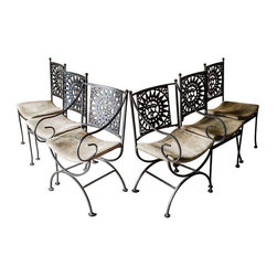 6 Arthur Umanoff Mayan Sun Chairs - Six wrought iron Mayan Sun chairs by Arthur Umanoff. Four side chairs and two armchairs. Great overall condition, although there are a few stains on the original beige upholstery. This set would look stunning reupholstered in black! Matching table with glass top available, listed separately. Please contact support@chairish.com to check stock.