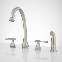 Torino Widespread Kitchen Faucet with Side Spray - This widespread kitchen faucet features graceful curves, a high-rise, gooseneck spout and a matching side spray. Its elegant design makes it complement a variety of kitchen styles, including contemporary and transitional.
