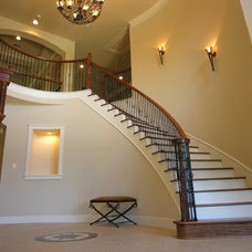 Traditional Staircase by Arte Architecture