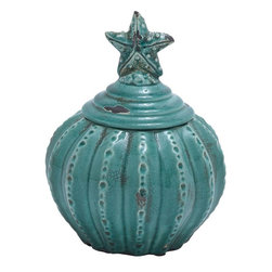 Benzara - Ceramic Jar with Star Shaped Design and Glossy Finish - Painted in a bright and vibrant blue color, this jar will be a great highlight when placed along with other decorative element in your living room. High on utility and performance, this ceramic jar will come in handy in organizing the countertops and dining tables in your kitchen. A perfect addition to your traditional kitchen decor, this ceramic jar sports a vintage inspired design. The pumpkin-styled jar looks stunning with beautiful finish and prefect pattern. While the star shaped design on the lid adds great charm to the jar, it also provides optimal grip for lifting up the lid conveniently. The glossy finish with crackled and weathered paint further enhances the jar with a rustic and antique look. Moreover, it is highly durable with long lasting performance for years to come.