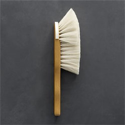 Redecker® Goat Hair Hand Brush - Handcrafted in Germany by the Redecker family of artisan brushmakers, this thoughtfully designed brush uses silky natural goat-hair bristles to sweep away dust without scratching fine furniture or glass surfaces. The sculptural beechwood handle is a pleasure to hold, honed to ergonomically fit the hand and rubbed smooth with a natural wax. To protect shelves and mantels, the brush head is outfitted with a felt bumper. This brush will stand the test of time with proper care, needing only a gentle shampoo.