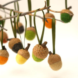 Acorn Ornaments by Fairyfolk - For a beautiful and kid-friendly centerpiece idea, gather some sticks from the yard, place them in a vase and hang these lovely felted acorns from the branches.