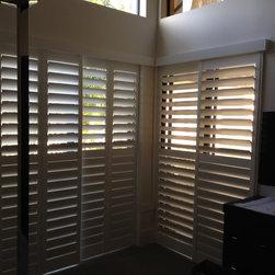 Freidman - ByPass Plantation Shutters on sliding glass doors in master bedroom.  Stephen Watson