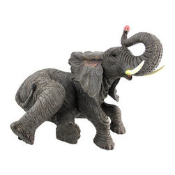 Lounging Elephant Indoor/Outdoor Statue - This lounging elephant statue adds a lovely accent in your home or outside in your garden or flower bed. Made of cold cast resin, it measures 14 1/2 inches tall, 16 inches long, and 12 inches wide. This piece is wonderfully detailed, from the texture of the elephant`s skin to its glossy eyes. The statue also has foam pads on the bottom to prevent it from scratching delicate surfaces. Elephant statues with raised trunks are believed to be lucky, this statue would make a great housewarming gift for a friend.