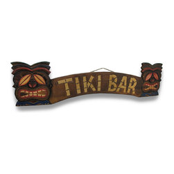 """Zeckos - """"Tiki Bar"""" Sign With Tiki Masks 39 In. - This wooden Tiki Bar sign is the perfect accent to beach restaurants, bars, patios, and more. It is hand crafted from Indonesian Albesia wood and features a cool tiki face on either end. It measures 39 inches (99 cm) long, 9 1/2 inches (24 cm) tall, 3/4 of an inch (2 cm) thick and it has a rope hanger on the back. It is a wonderful accent above a doorway, or is the finishing touch for your home tiki bar. Note: These signs are hand crafted and may differ slightly from the one pictured."""