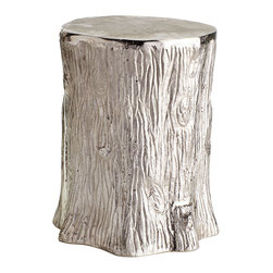 METALLIC FAUX-BOIS STOOL - NEW - Inspired by the real deal (sans the wood, naturally) this stump stool—juxtaposing current materials with organic lines—is the perfect combination of modern and rustic. The silvery finish contemporizes this stool, making it a great addition to the end of the sofa to set down drinks, a last minute seating solution, or a purely decorative accent.
