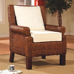 Banana Leaf Woven Chair - The chair's sturdy wood frame is wrapped in woven banana leaf that provides incredible texture and an stunning natural look.