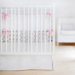 New Arrivals - New Arrivals Crib Bedding Sweet & Simple White - Reflecting the whimsy and joy of life, New Arrivals delivers fun and function to a child's room. The Sweet & Simple crib bedding's beautiful mix of print and solid color fabrics awakens a space with contemporary style. This pink and white linen set includes a sophisticated bumper and bed skirt. Optional crib sheet available. Bumper offers optional customizable initials, first name, middle name or last name monogram in a variety of fonts and hues. Crib sheet and crib skirt made in the USA.